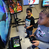 Maliya Brunson, 9, and her brother BJ, 7, play Teenage Mutant Ninja Turtles on XBox 360 at the Northside Boys and Girls Club location in Tupelo on Friday afternoon. Six gaming consoles along with TV's and stands were donated along with furniture to go in the gameroom. The same donations were also made to the Haven Acres location.