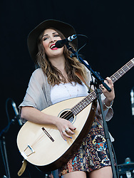 © Licensed to London News Pictures. 13/06/2015. Newport, UK.   Ward Thomas performing live at Isle of Wight Festival 2015, Day 3 Saturday. In this picture - Catherine Ward Thomas. This afternoon as started with warm sunshine.  Yesterday the rain was torrential.  Headline acts include The Prodigy, Blur and Fleetwood Mac.   Photo credit : Richard Isaac/LNP