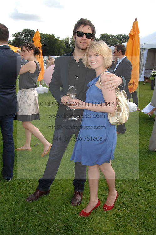 Actor RAIFE BURCHELL and actress EVA BIRTWISTLE at the final of the Veuve Clicquot Gold Cup 2007 at Cowdray Park, West Sussex on 22nd July 2007.<br />