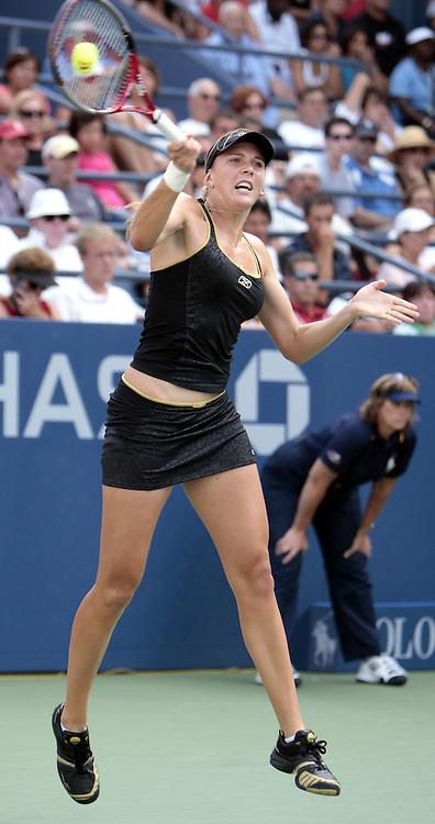 Nicole Vaidisova of the Czech Republic hits a forehand return to Flavia Pennetta of Italy during their second round match on the fourth day of the 2007 US Open tennis tournament in Flushing Meadows, New York, USA, 30 August 2007.