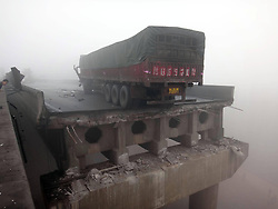 Photo taken on Feb.1, 2013 shows the accident site where an expressway bridge partially collapsed due to a truck explosion in Mianchi County, Sanmenxia, central China's Henan Province, February 1, 2013. Photo by Imago / i-Images..UK ONLY