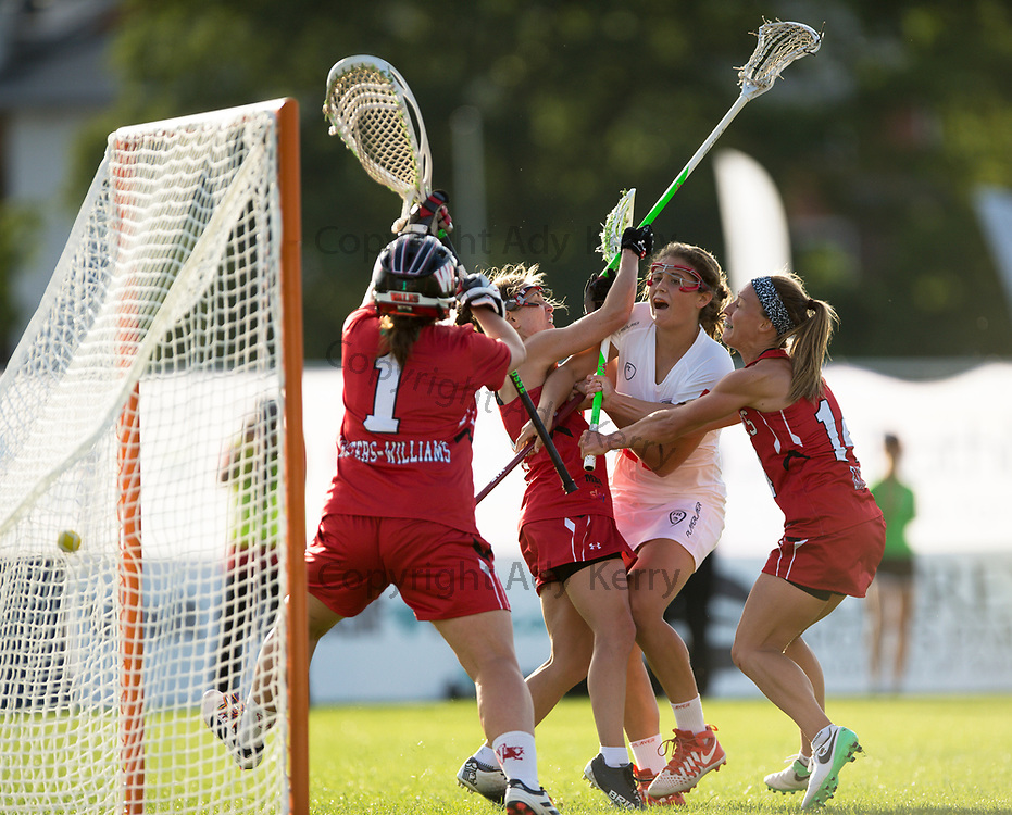 England's Olivia Hompe gets a shot on goal against Wales during their opening game of the 2017 FIL Rathbones Women's Lacrosse World Cup, at Surrey Sprts Park, Guildford, Surrey, UK, 12th July 2017.