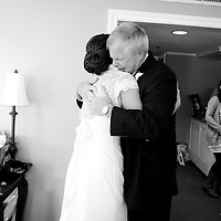 Melissa gets a hug from her father before her Seattle wedding.