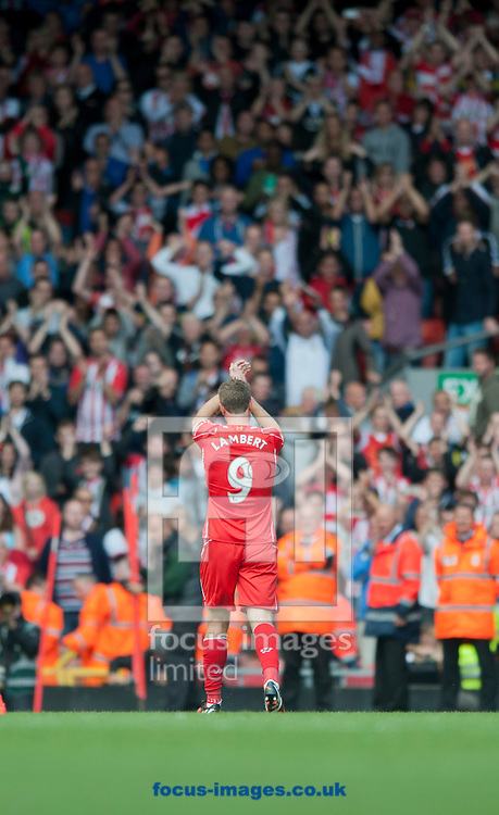 Rickie Lambert of Liverpool acknowledges the travelling supporters from Southampton following during the Barclays Premier League match at Anfield, Liverpool<br /> Picture by Russell Hart/Focus Images Ltd 07791 688 420<br /> 17/08/2014