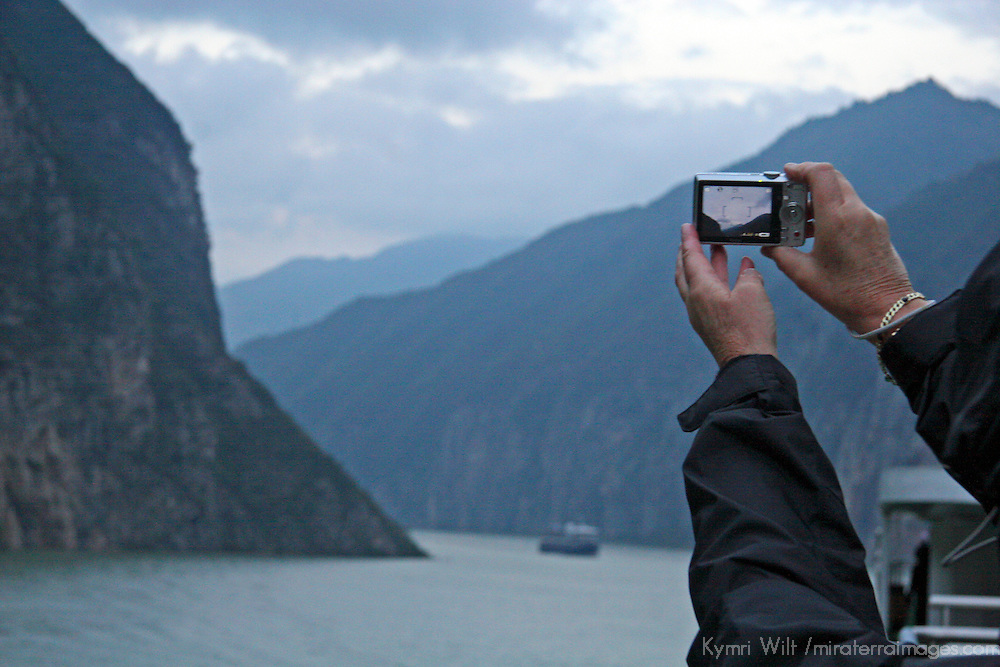 Asia, China, Yangtze River. Tourist taking a picture from a cruise along the Yangtze.