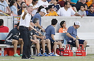 Jun 29, 2016; Houston, TX, USA; Sporting Kansas City head coach Peter Vermes screams as his team plays against the Houston Dynamo in the second half at BBVA Compass Stadium. Dynamo won 3 to 1. Mandatory Credit: Thomas B. Shea-USA TODAY Sports