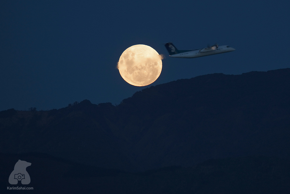 WELLINGTON, New Zealand, 6 May 2012. Rotorua bound Air New Zealand flight NZ8588 passes in front of the rising 'super moon' whose elliptical orbit places it at its closest to Earth for the year.