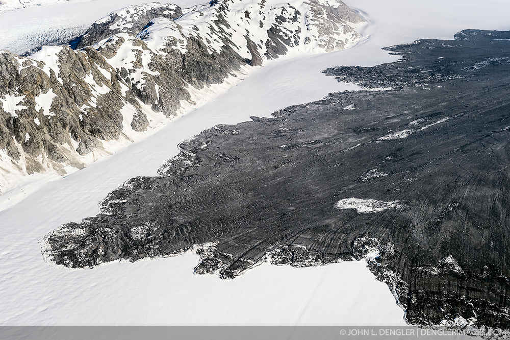 A 4,000-foot-high mountainside released approximately 120 million metric tons of rock in 60 seconds during a landslide onto the Lamplugh Glacier in Glacier Bay National Park and Preserve. In an interview with the Alaska Dispatch News, geophysicist Colin Stark of Columbia University's Lamont-Doherty Earth Observatory, described the slide as &ldquo;exceptionally large.&rdquo; He compared the massive landslide to roughly 60 million medium SUVs tumbling down a mountainside.<br /> <br /> Mountainsides that were held strong by the heavy ice of glaciers become weak when the glaciers retreat. Erosion along with earthquakes are triggers that can cause the weakened slopes to collapse.<br /> <br /> The slide occurred on the morning of June 28  in a remote area of Glacier Bay National Park in southeast Alaska. It was first observed by Paul Swanstrom, pilot and owner of Haines-based Mountain Flying Service. Swanstrom noticed a huge cloud of dust over the Lamplugh Glacier during a flightseeing tour of Glacier Bay National Park several hours after the slide occurred. Swanstrom estimates the debris field to be 6.5 miles long, and one to two miles in width.<br /> <br /> This aerial photo of the Lamplugh Glacier landslide was taken two days after the landslide.