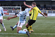 Harrogate Town midfielder Joe Leesley (11) under pressure from Braintree Town defender Jonathan Muleba (2) during the Vanarama National League match between FC Halifax Town and Dover Athletic at the Shay, Halifax, United Kingdom on 17 November 2018.