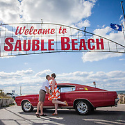 Jacqueline and Jeff celebrate their wedding day under the Sauble Beach sign with a 1967 Dodge Charger. (Sept 12, 2015)