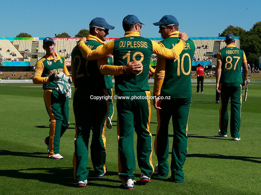 Rilee Rossouw of South Africa with Faf du Plessis and David Miller walk onto the feild before the ICC Cricket World Cup warm up game between New Zealand v South Africa at Hagley Oval, Christchurch. 11 February 2015 Photo: Joseph Johnson / www.photosport.co.nz