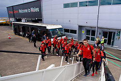 CARDIFF, WALES - Saturday, June 10, 2017: Wales' Sam Vokes leads his squad as they board the team plane as the squad depart Cardiff Tesla Airport to travel to Belgrade ahead of the 2018 FIFA World Cup Qualifying Group D match against Serbia. (Pic by David Rawcliffe/Propaganda)