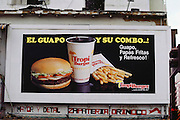 Tropi Burger billboard above Sabana Grande shops in Caracas, Venezuela.