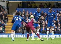 Football - 2019 / 2020 Premier League - Chelsea vs. West Ham United<br /> <br /> Michail Antonio (West Ham United) nips in between 3 Chelsea defenders to force a save from the Chelsea keeper at Stamford Bridge <br /> <br /> COLORSPORT/DANIEL BEARHAM