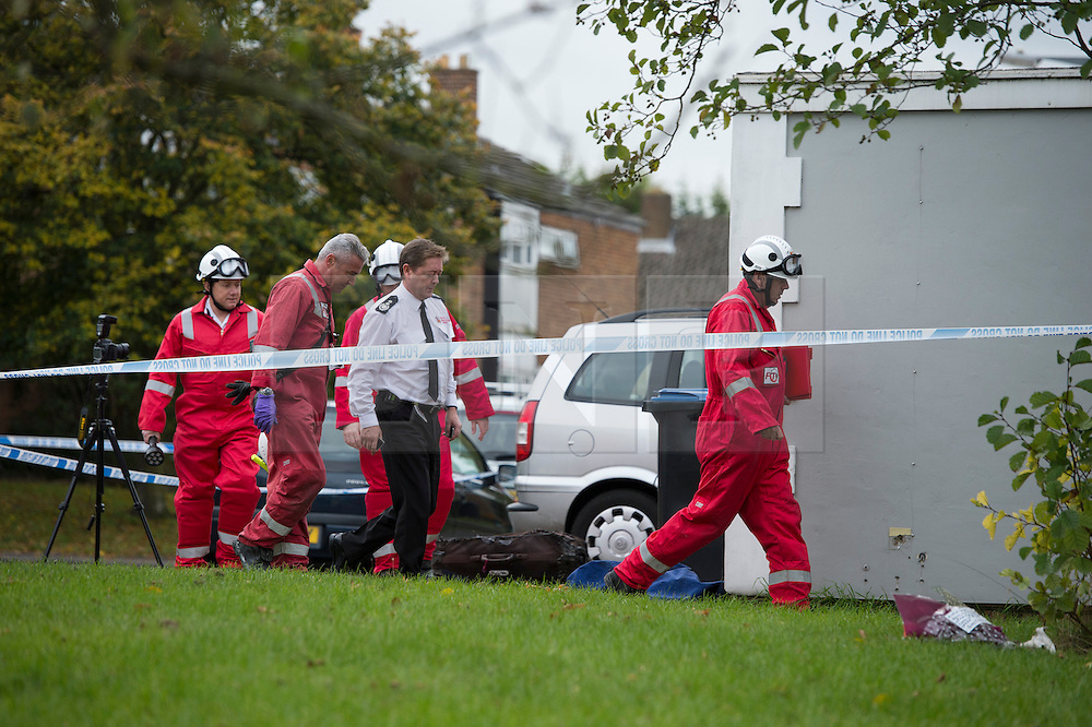 ©  London News Pictures. 15/10/2012. Harlow, UK. A fire investigation tenter the property  on Barn Mead, Harlow, Essex where three children and a woman have died and three others are in hospital following a house fire. Two boys aged 13 and six, a girl aged 11 and the woman were declared dead at the scene. A nine-year-old boy and a three-year-old girl have serious burns and a man has minor burns. Photo credit : Ben Cawthra/LNP