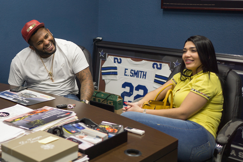 DORAL, FLORIDA, DECEMBER 11, 2015<br /> Alex Vega, owner of The Auto Firm, a South Florida car customizing and restoring shop which has a vast clientele of professional athletes and entertainers, meets with client Pablo Sandoval and wife Yulimar Martins in his office. Sandoval was picking up his customized Range Rover.(Photo by Angel Valentin/Freelance)