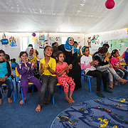 "Fun at the Mercy Corps child friendly space ""Tom and Jerry"" helps the children adjust to their situation as refugees. Azraq camp for Syrian refugees, Jordan, May 2015."