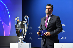 NYON, SWITZERLAND - Friday, July 10, 2020: Presenter Pedro Pintor with the European Cup trophy during the UEFA Champions League and UEFA Europa League 2019/20 draws for the Quarter-final, Semi-final and Final at the UEFA headquarters, The House of European Football. (Photo Handout/UEFA)