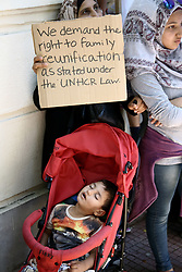 July 19, 2017 - Athens, Greece - Protest rally by refugees and migrants outside the German embassy in Athens on Wednesday 19 July 2017. The refugees, mainly Syrians from the refugee camps of Ritsona and Skaramagas complain about the delays in the family reunification program, demanding permission to travel to Germany  (Credit Image: © Panayotis Tzamaros/NurPhoto via ZUMA Press)