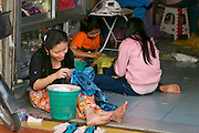 Phnom Penh, Cambodia. Textile workers at a small manufacture.
