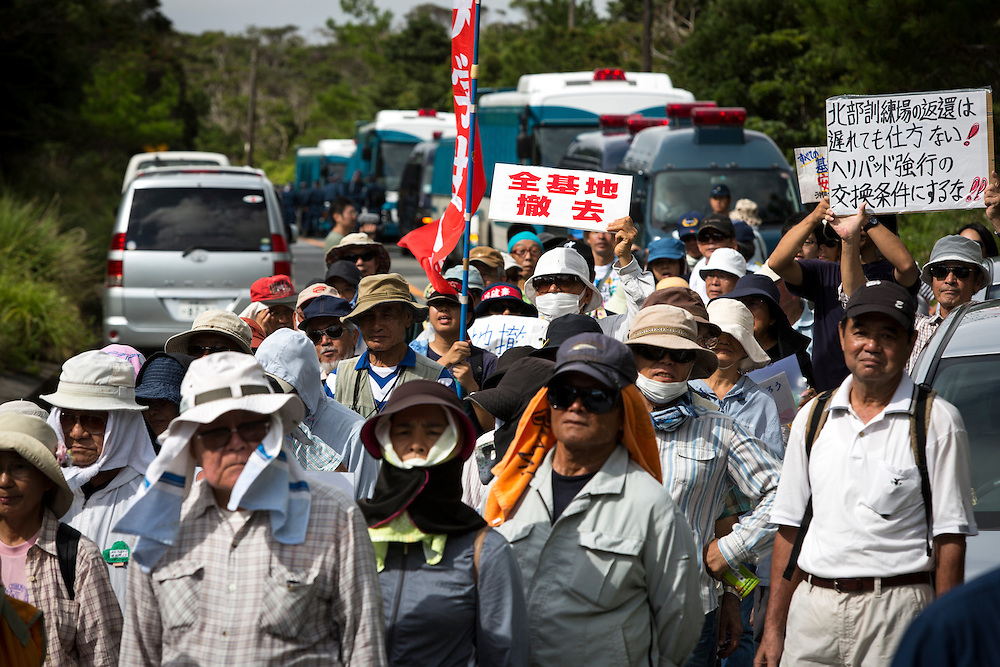 OKINAWA, JAPAN - SEPTEMBER 14 : Anti U.S base protesters is seen with placards as they protest against the construction of helipads in front of the gate of U.S. military's Northern Training Area in the village of Higashi, Takae, Okinawa Prefecture, Japan on September 14, 2016. The Japanese government is allowing the use of its own Japan Air Self-Defense Force military helicopters Boeing CH-47 to get construction heavy equipments past the protesters on Tuesday, September 13 in order to speed up completion of six new helipads to be use by U.S Military.  (Photo by Richard Atrero de Guzman/NURPhoto)