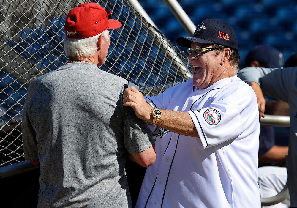 Pete Rose, right, shares a light moment with Lancaster Barnstormers manager Butch Hobson, left, during batting practice at The Ballpark at Harbor Yard, Monday, June 16, 2014, in Bridgeport, Conn. Rose, banned from Major League Baseball, returned to the dugout for one day to manage the independent minor-league Bridgeport Bluefish. (AP Photo/Jessica Hill)