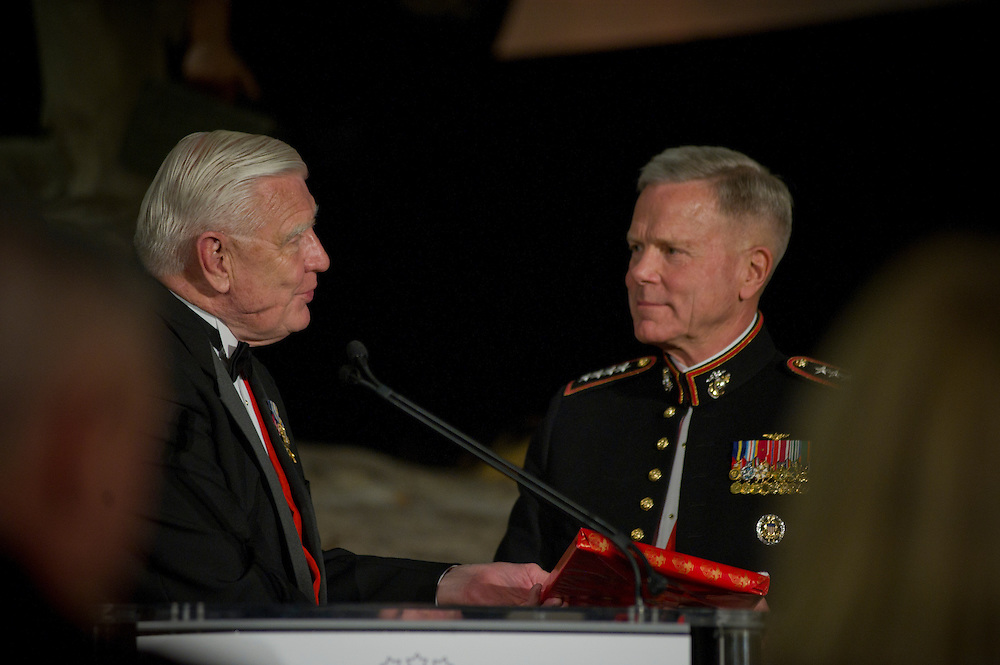 Triangle, Va., (April 16, 2011) -- The Marine Corps Heritage Foundation hosts a dinner to presents a series of awards to both Marines and civilian community members, recognizing their exemplary work in advancing and preserving Marine Corps history. Honorees this year includes the Chairman, President and CEO of FedEx Corporation Fred W. Smith, a Marine, and HBO. Among the Foundation and National Museum supporter attendees at the April 16, 2011 ceremony will be Commandant of the Marine Corps General James F. Amos. Marine Corps Heritage Foundation President & CEO Lieutenant General Ron Christmas, USMC (Ret) who presented the awards. Photo by Johnny BIvera