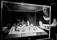 Woman looking at a display in the gem and mineral hall of the  Natural History Museum of Los Angeles County