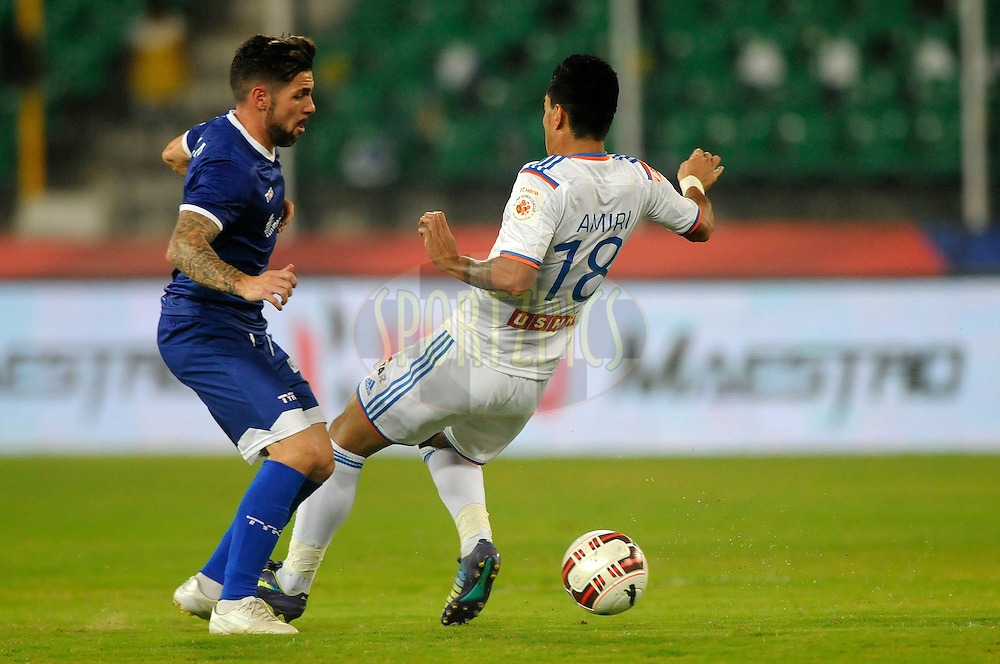 Cristian Hidalgo Gonzalez of Chennaiyin FC and Haroon Fakhruddin of FC Goa during match 50 of the Hero Indian Super League between Chennaiyin FC and FC Goa held at the Jawaharlal Nehru Stadium, Chennai, India on the 5th December 2014.<br /> <br /> Photo by:  Pal Pillai/ ISL/ SPORTZPICS