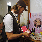 Mark Lunsford, the father of Jessica Lunsford who was abducted and murdered, reads part of his daughter's diary while standing in her bedroom Tuesday, June 14, 2005 in Homosassa. Since the death of his daughter in February, Lunsford has turned to lobbying in an attempt to keep sex offenders from re-committing crimes.