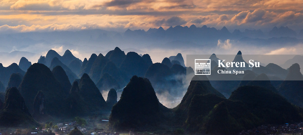Landscape of karst hills with farmland in morning mist, Rongshui, Guangxi Province, China