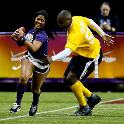 Jan 31, 2013; New Orleans, LA, USA; NFC squad Maripily Rivera has her flag grabbed by AFC squad Derrick Brooks during the Tazon Latino VII flag football game at Clinic Field  inside the Ernest Morial Convention center. Super Bowl XLVII will take place between the San Francisco 49ers and the Baltimore Ravens on February 3, 2013 at the Mercedes-Benz Superdome.  Mandatory Credit: Derick E. Hingle-USA TODAY Sports