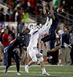 Kingwood's Ethan Powell, right, breaks up a pass intended for Atascocita's Taylor Stump as Kingwood's Logan Clift defends during the first half of a high school football game, Friday, October 25, 2013 at Turner Stadium in Humble. (Photo:Eric Christian Smith/For the Chronicle)