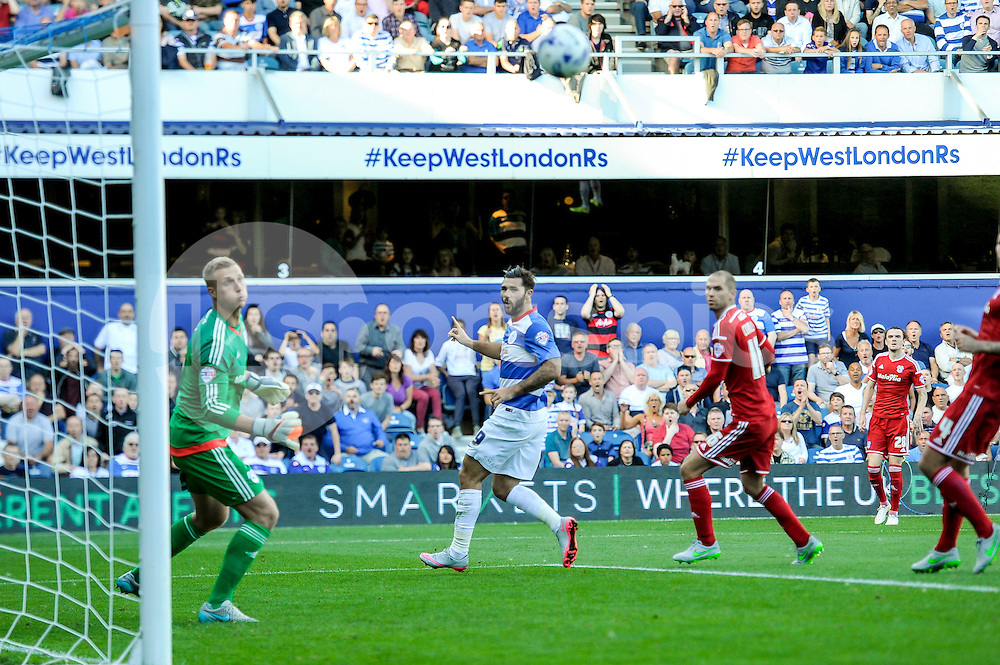 Charlie Austin of Queens Park Rangers misses a chance with a header during the Sky Bet Championship match between Queens Park Rangers and Cardiff City at the Loftus Road Stadium, London, England on 15 August 2015. Photo by Salvio Calabrese.