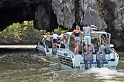 Star Flyer passengers visit limestone rock islands at Phang Nga Bay by speedboat.