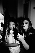 Two female gang members gesturing, with a gun, LA, USA, 1990's