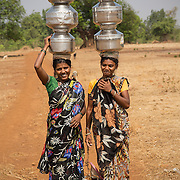 MAHARASHTRA, INDIA - MAY 29, 2015: Fetching water in a drought-stricken Denganmal village at Maharashtra, India. <br />