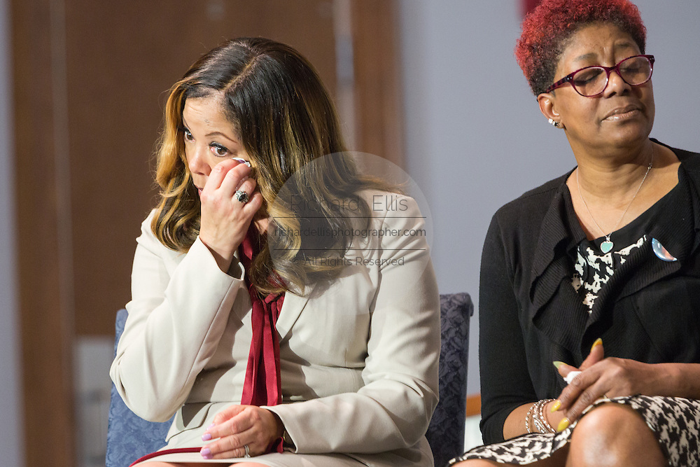 Lucy McBath, mother of Jordan Davis wipes away a tear during the Breaking Down Barriers Forum on gun violence held by Democratic presidential candidate Hillary Rodham Clinton at Central Baptist Church February 23, 2016 in Columbia, South Carolina. McBath's son Jordan Davis was shot and killed for playing his music too loud in Florida.