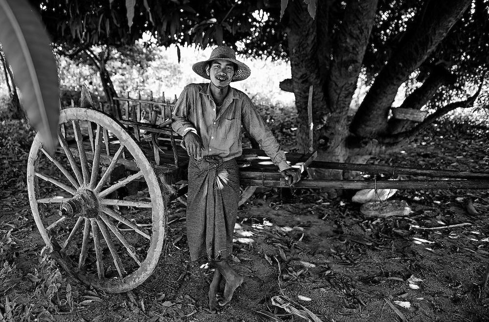 A farmer cools down under a mango tree near Inle lake, Myanmar.