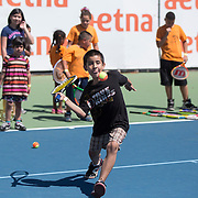 August 19, 2014, New Haven, CT:<br /> Kids play tennis during the Latino Day tennis clinic on day five of the 2014 Connecticut Open at the Yale University Tennis Center in New Haven, Connecticut Tuesday, August 19, 2014.<br /> (Photo by Billie Weiss/Connecticut Open)