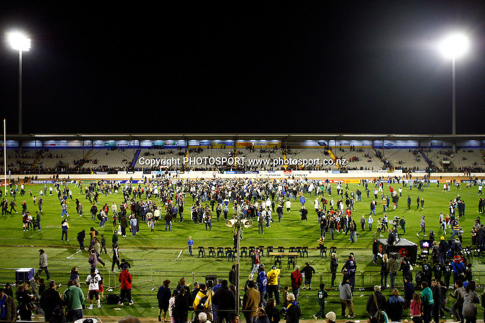 Fans invade the field after the win by Bay of Plenty, Air NZ Cup, NPC rugby union. Bay of Plenty v Canterbury. Bay Park Stadium, Mt Maunganui. 5 September 2009. Photo: William Booth/PHOTOSPORT