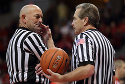 29 November 2014:  Referee Rick Randall and Terry Davis discuss the game at a time out during an NCAA men's basketball game between the Youngstown State Penguins and the Illinois State Redbirds  in Redbird Arena, Normal IL.