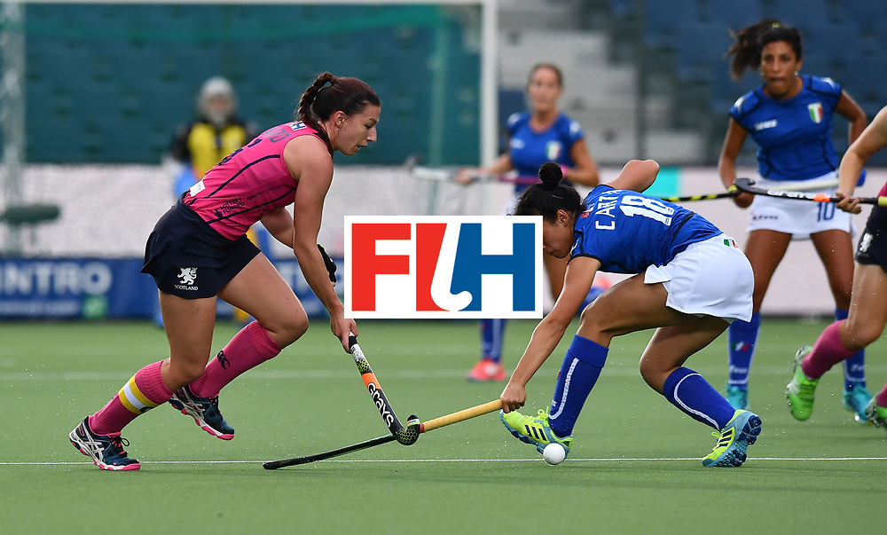 BRUSSELS, BELGIUM - JUNE 24: Federica Carta (R) of Italy and Becky Ward (L) of Scotland during the FINTRO Women's Hockey World League Semi-Final Pool A game between Italy and Scotland on June 24, 2017 in Brussels, Belgium. (Photo by Charles McQuillan/Getty Images for FIH)