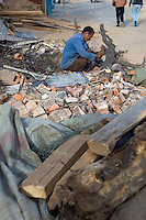 "China, Beijing, Chaoyang, San Jian Fang, 2008. A ""wood man"" salvages anything he can carry on his pushcart from Chaoyang Street demolition sites.."