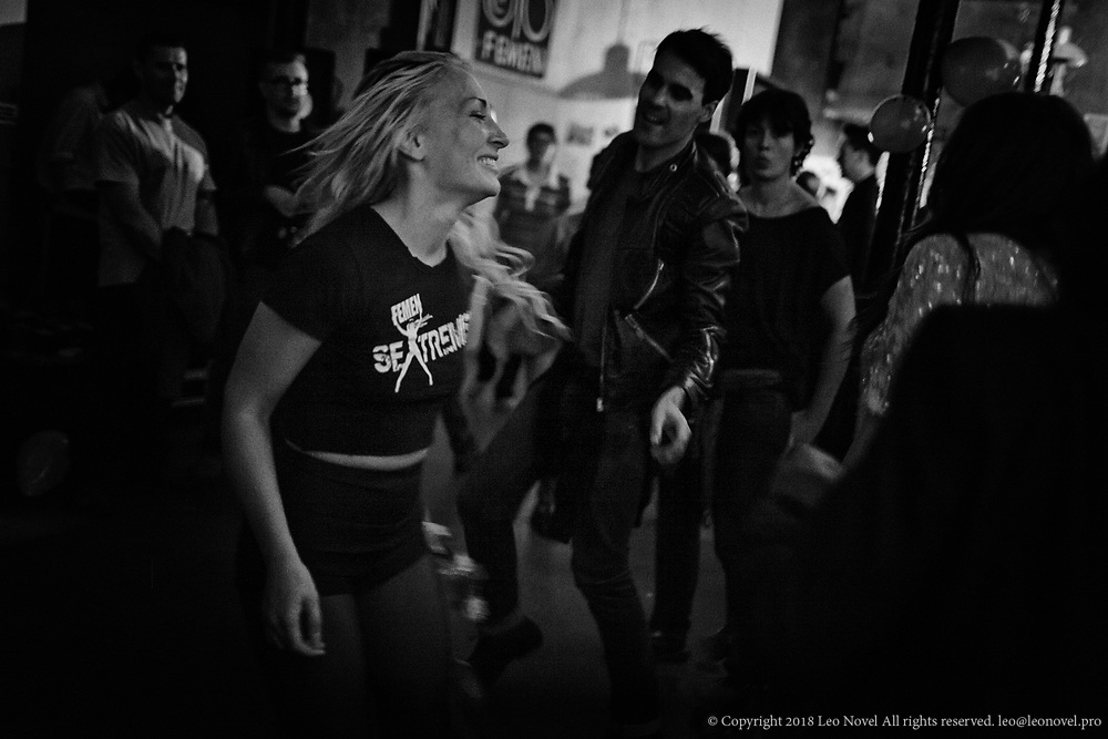 The first anniversary of Femen opening their headquarters in France. Inna dances with guests.
