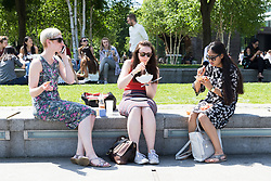 © Licensed to London News Pictures. 26/05/2017. LONDON, UK.  Office workers and tourists enjoy the sunshine on the south bank at lunchtime. The capital has experienced another day of hot and sunny weather. Photo credit: Vickie Flores/LNP