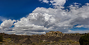 Building cumulus clouds portent of a storm coming to badlands in northwestern New Mexico , © 2017 David A. Ponton