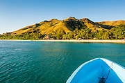 Blue boat cruising through the Yasawas, Fiji, South Pacific