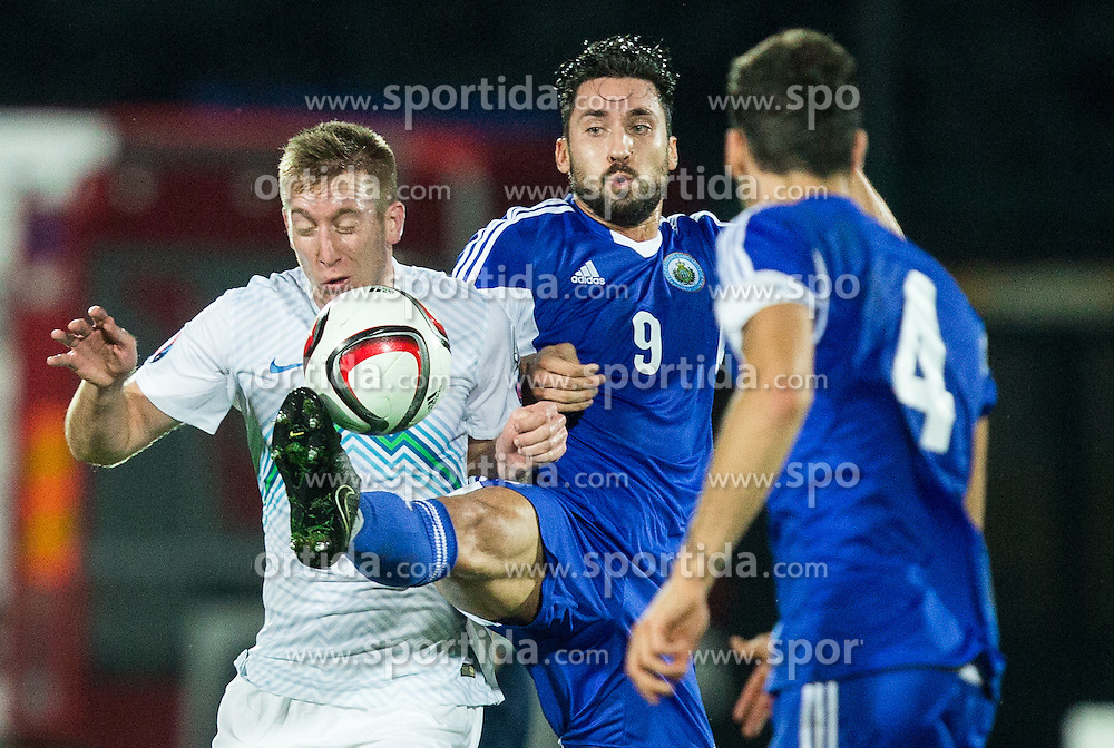 Robert Beric of Slovenia vs Mirko Palazzi of San Marino during football match between National teams of San Marino and Slovenia in Group E of EURO 2016 Qualifications, on October 12, 2015 in Stadio Olimpico Serravalle, Republic of San Marino. Photo by Vid Ponikvar / Sportida