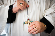 The Rev. Dr. Michael Kumm, chairman of the LCMS Board of Directors, adjusts his pectoral cross crucifix before the dedication of The International Lutheran Center at the Old Latin School on Sunday, May 3, 2015, in Wittenberg, Germany. The building is the culmination of the joint effort by the LCMS, the Independent Evangelical Lutheran Church (SELK), and the International Lutheran Society of Wittenberg (ILSW), to establish a distinctly Lutheran presence in the very cradle of the Reformation. LCMS Communications/Erik M. Lunsford